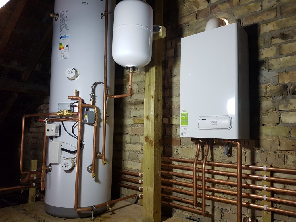 New boiler and unvented cylinder installation works in loft space in Cambridge.