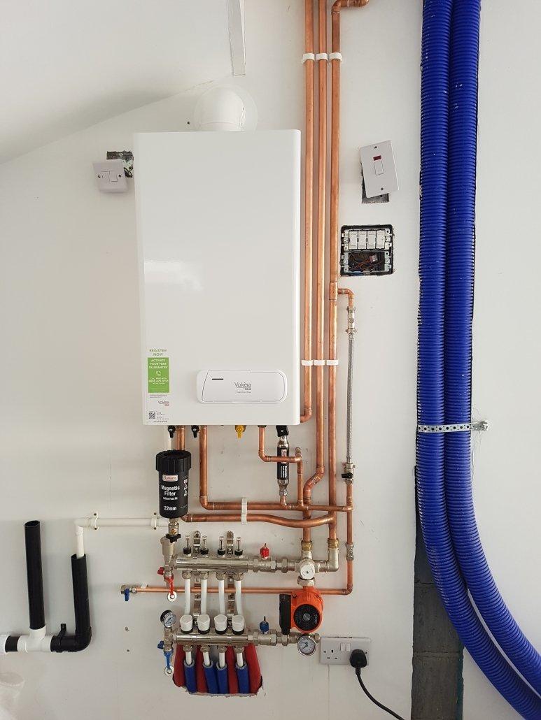 Combination boiler with underfloor heating and radiators installed in Cambridge